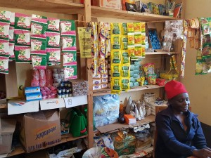 Valentine runs our grocery shop and the other extra services offered by Upper Planet at Kitukunyi